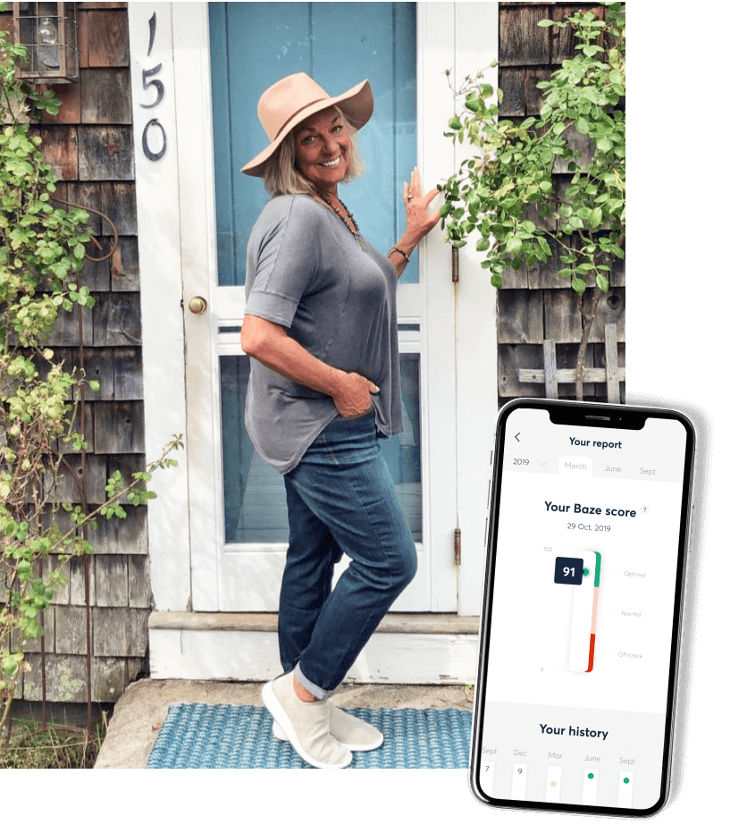 Happy Baze customer standing in front of her house. Phone showcasing happy Baze customer's Nutrient Report and optimal Baze Score of 91